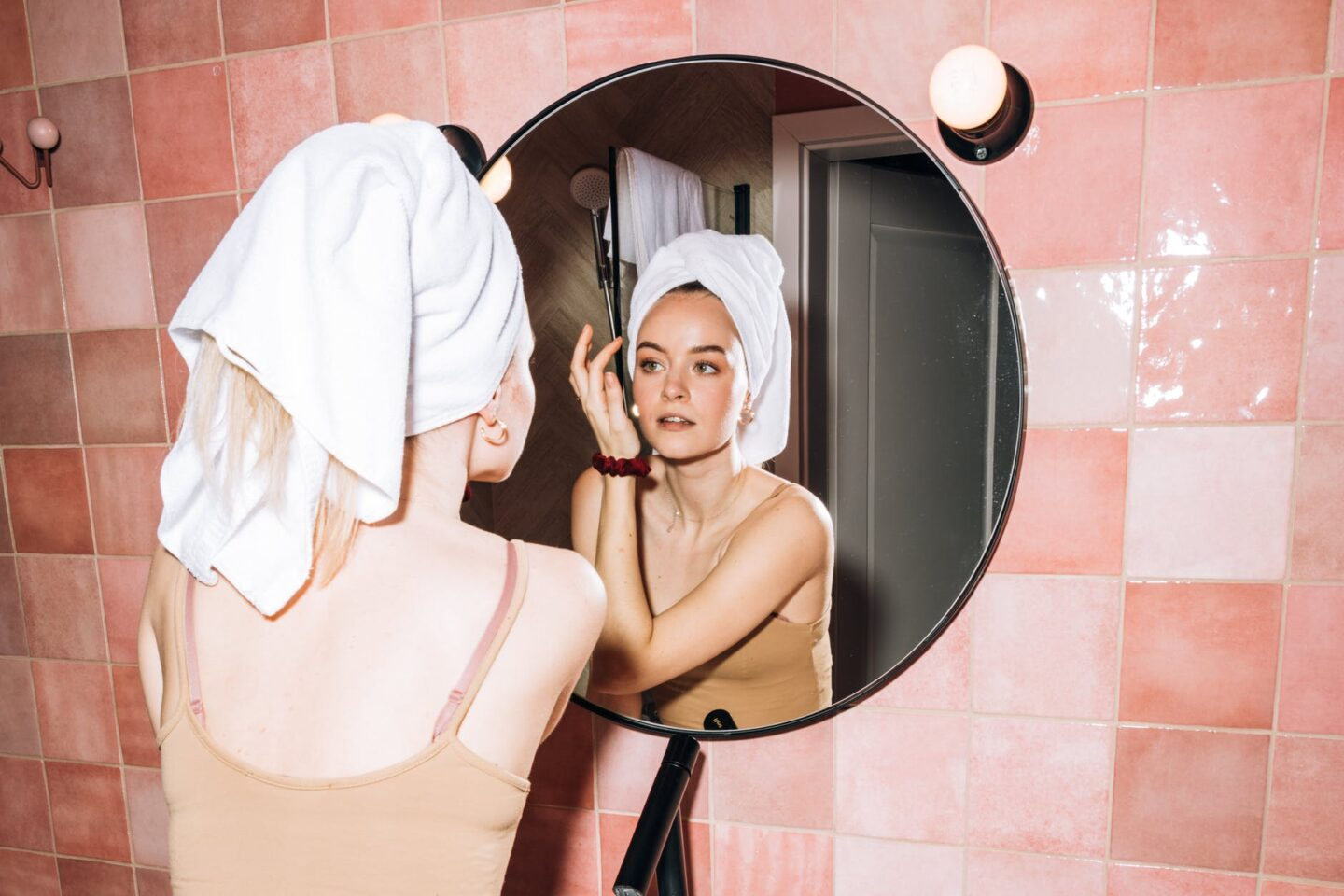 young woman doing her facial skin care